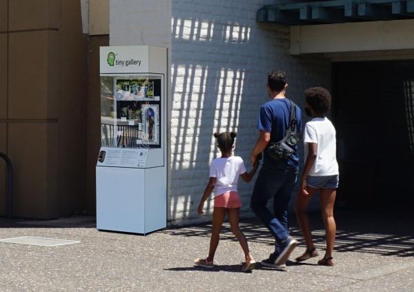 A family enjoys the Tiny Gallery on 4th Street